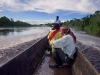 Traveling by canoe on the Pastaza River with Achuar Indians on the way to the village of Sharamentza.