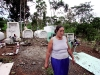 Juana Apolo walks out of a cemetery in La Andina where her father, brother and sister are buried, all of whom died of cancer.